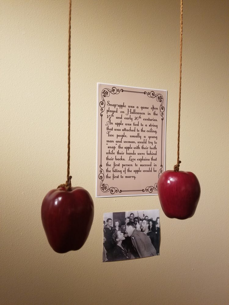 Snap-apple was a popular parlor game aimed towards single young adults. A man and woman would try to bite an apple on a string with their hands tied behind their back!